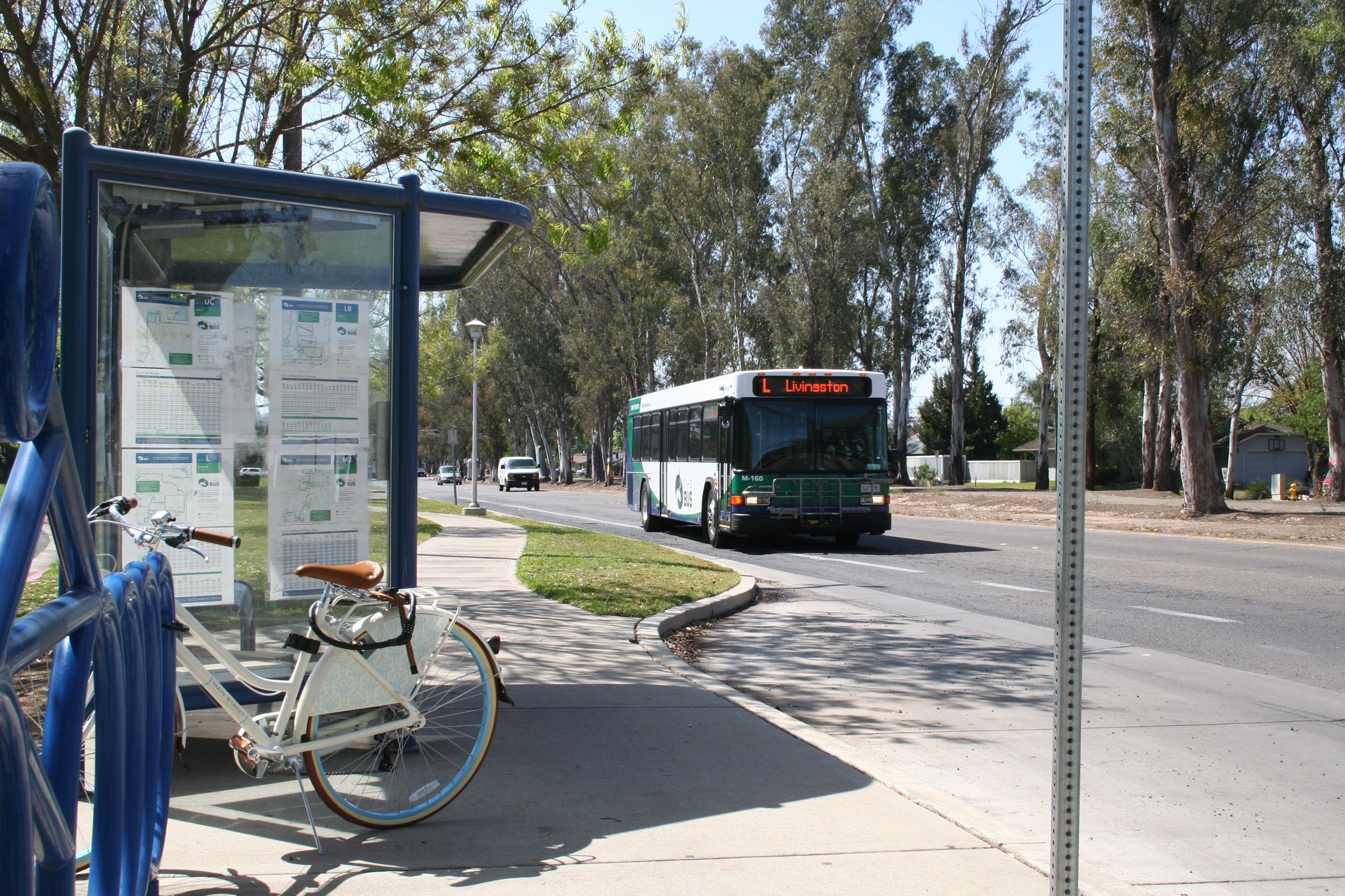 L - approaching bus stop with bicycle